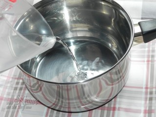 Pouring distilled water into heat proof container